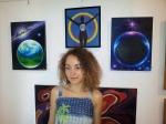 The artist Corina Chirila and the paintings Ancient Mars I have the world and Gliese 581g in Herastrau Park - Picturi de Corina Chirila la salonul de arta moderna al AAPB