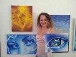 Pictorita Corina Chirila cu tablourile Dansul Ieielor Privirea rece a iernii si Privind Pamantul la expozitie in Herastrau galeria de arta AAP